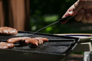 Person grilling outside in order to save energy
